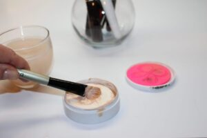 swipe brush on cleansing bar to get a good lather