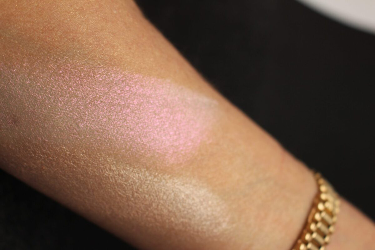 top is swatch of pigment with iridescent pink - bottom is swatch of shiny nude highlighter