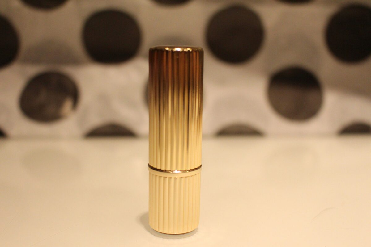 The Lipstick Bullet is gold with etchedc vertical line pattern-really beautiful