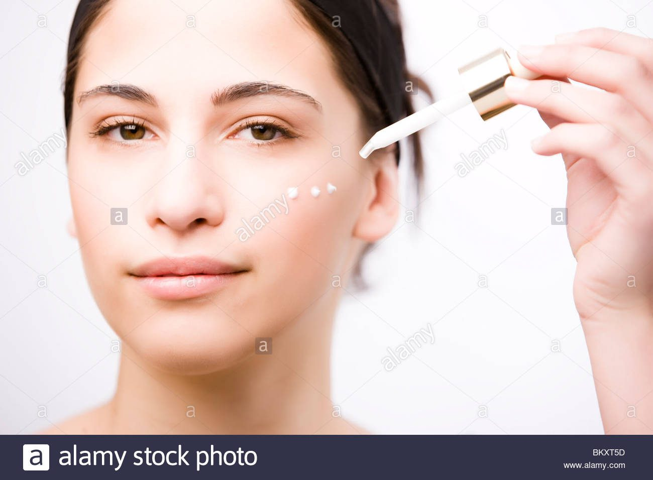 skincaresteps-close-up-of-a-young-woman-applying-an-anti-aging-serum-on-her-face