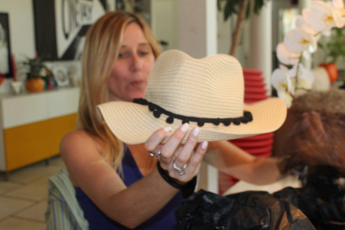 Fist Bikini pulls out a straw hat