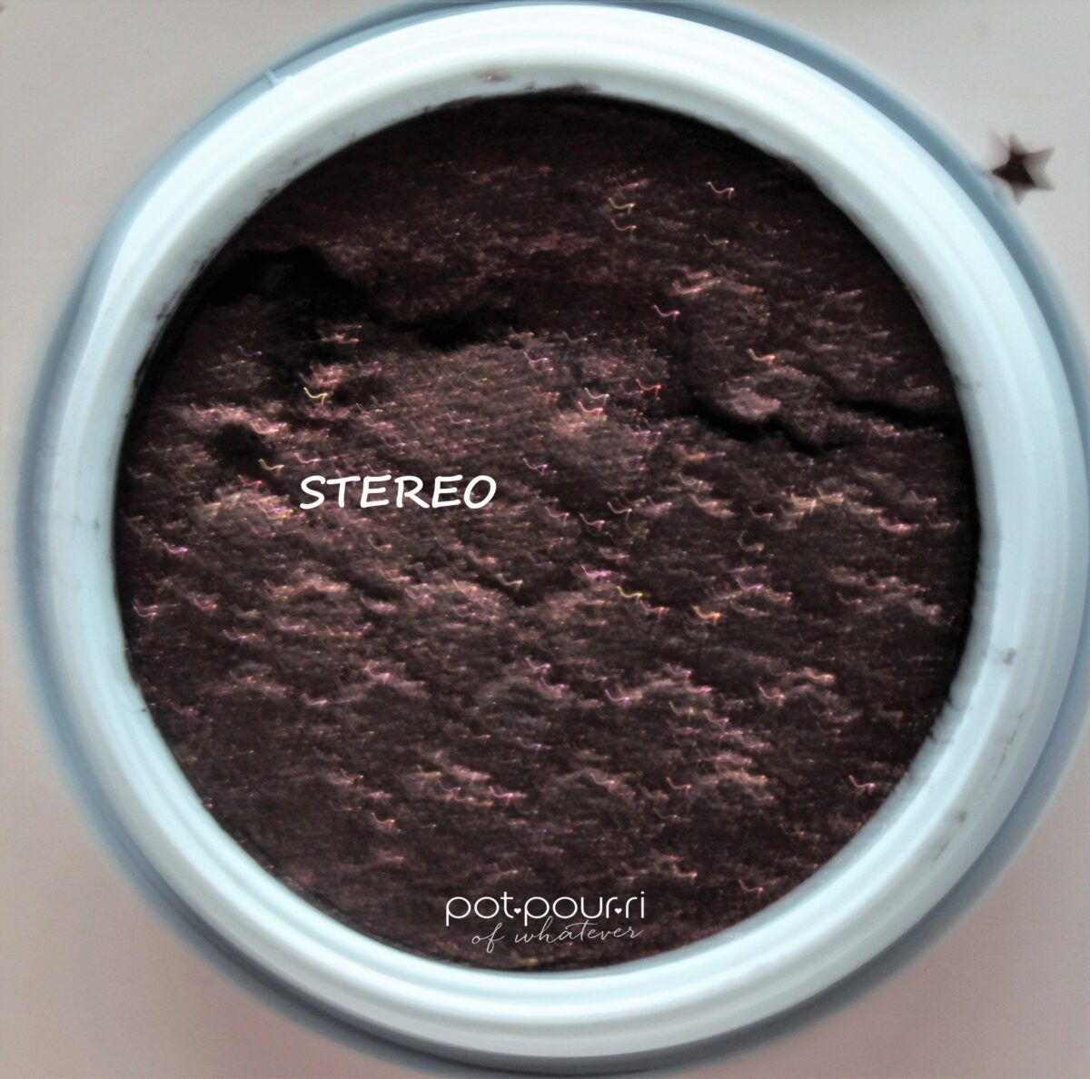 Colourpop-stereo-blackened-purple-with-gold-and-pink-glitter