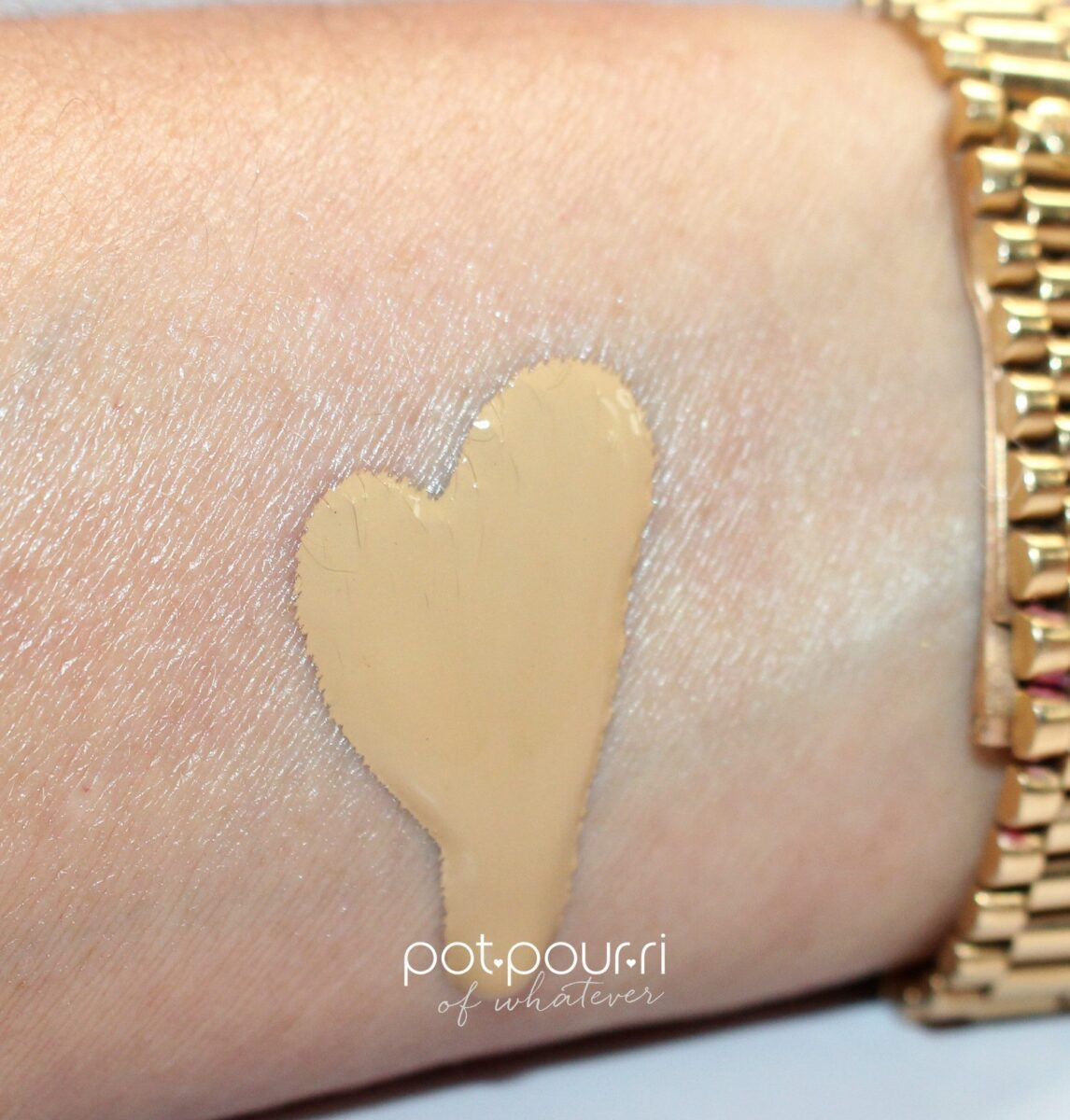 A heart-shaped swatch of the Luminous Silk Microfil formula