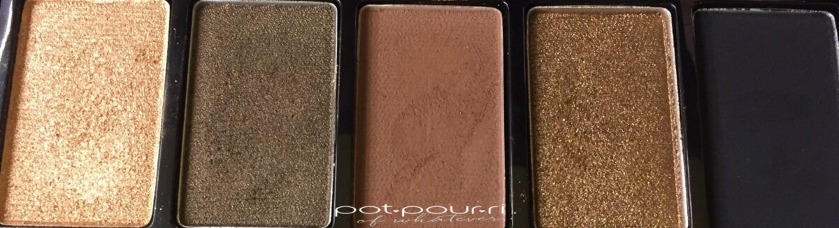 VISTA EYE SHADOW COLORS LEFT TO RIGHT CHAMPAGNE GOLD, DEEP OLIVE, RICH BROWN, BRONZE BLACK