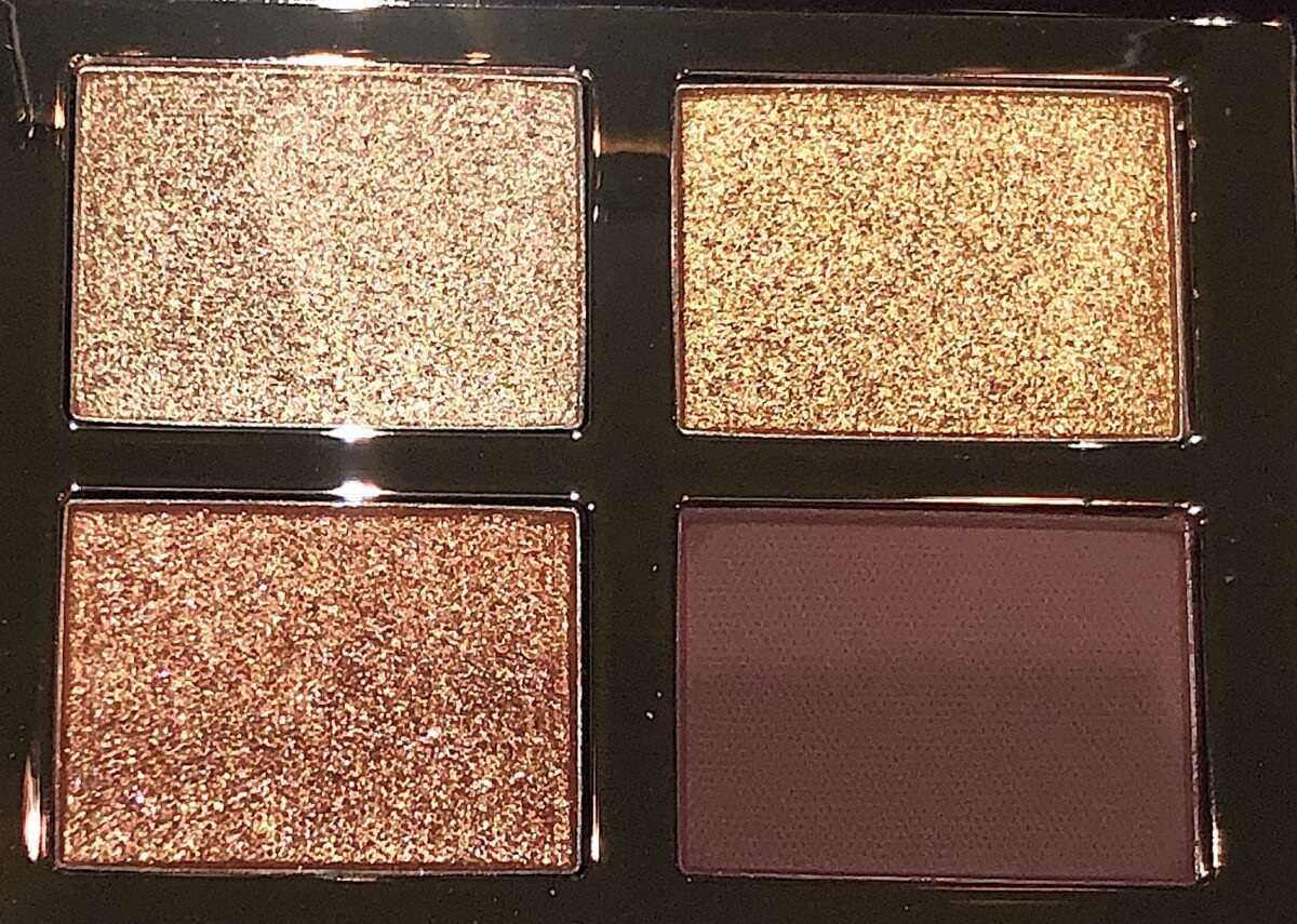 CLOSEUP OF SHADES IN CHARLOTTE TILBURY QUEEN OF GLOW QUAD