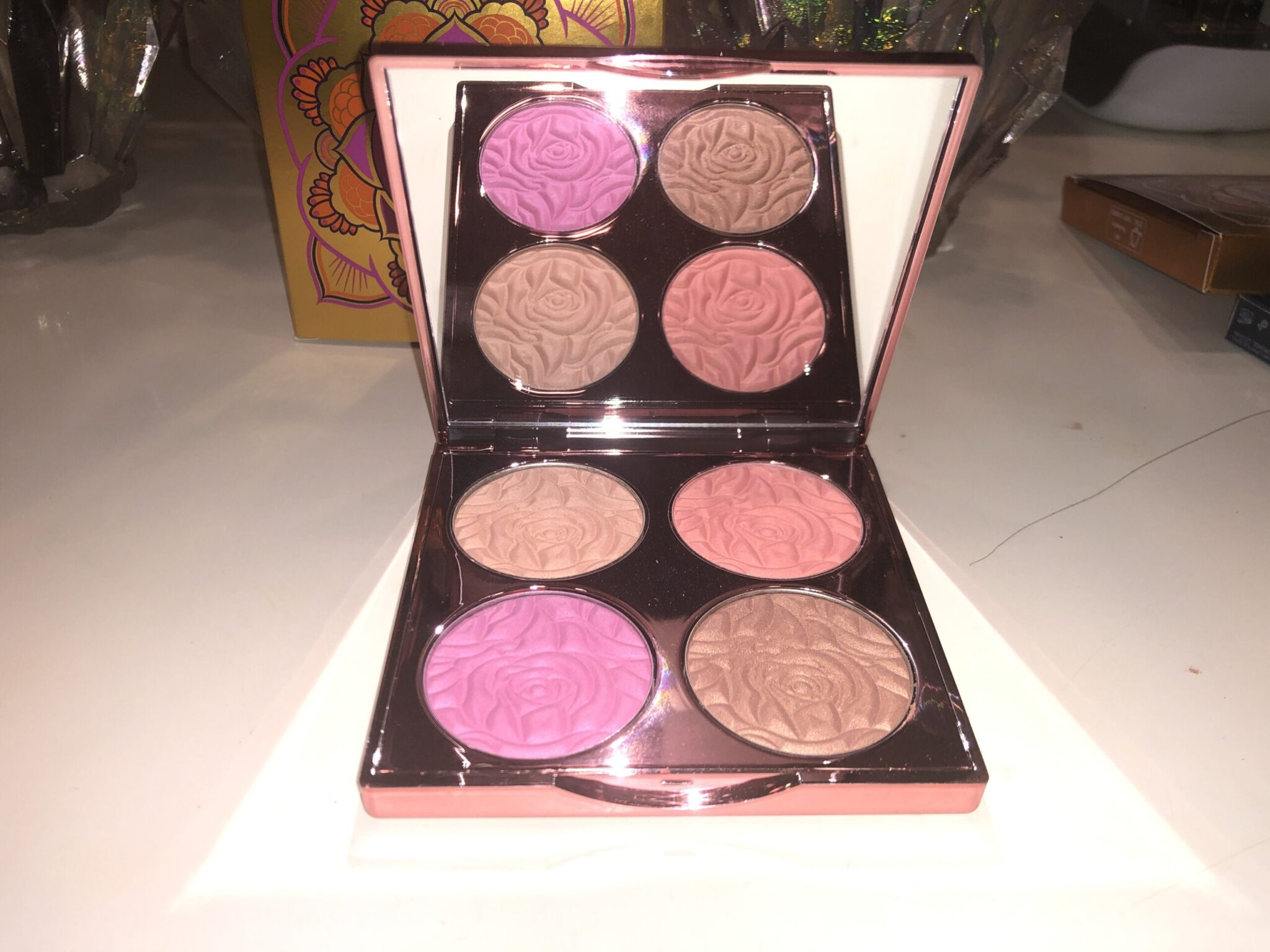 INSIDE THE BEACH BOMB PALETTE IS A MIRROR, AND FOUR PANS WITH EMBOSSED POWDERS