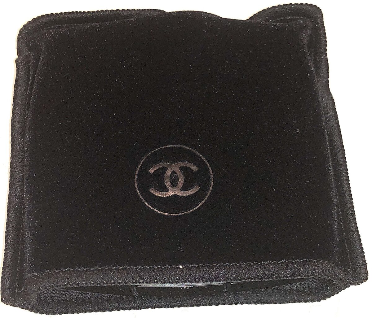 INSIDE THE VELVET POUCH IS THE CHANEL LES 4 OMBRES EYESHADOW PALETTE
