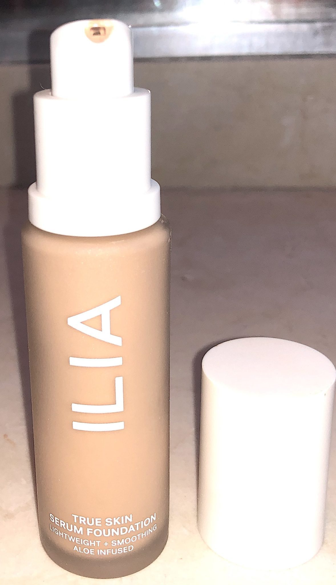 THE PUMP AND GLASS BOTTLE FOR THE ILIA TRUE SKIN SERUM FOUNDATION