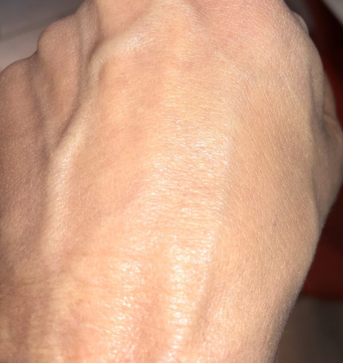 SWATCH OF SHADE 3N1 IVORY BEIGE BLENDED INTO MY HAND