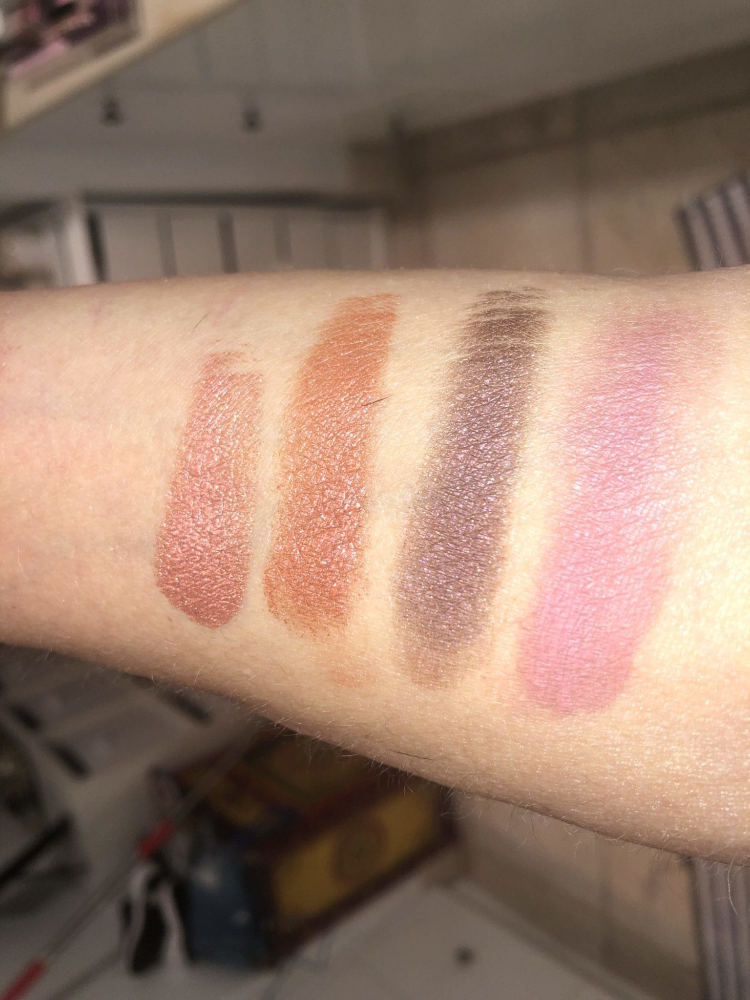 ORGASM X QUAD EYESHADOW SWATCHES L TO R: PINK RUST SHIMMER, S[ARLING AMBER, BLACK W RED SHIMMER, DUSTY. ROSE MATTE
