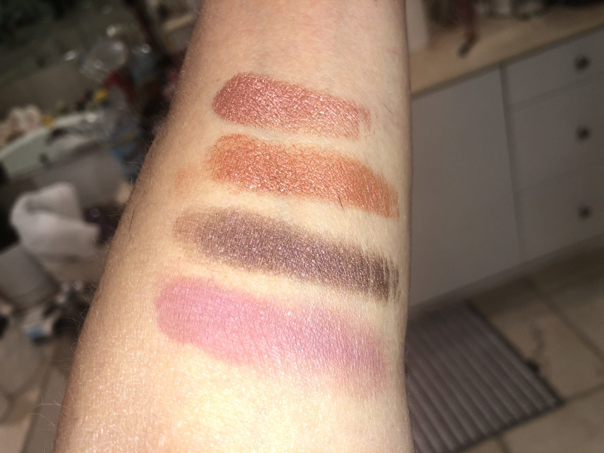SWATCHES TOP TO BOTTOM: PINK RUST SHIMMER, SPARKLING AMBER, BLACK WITH RED SHIMMER, DUSTY ROSE MATTE