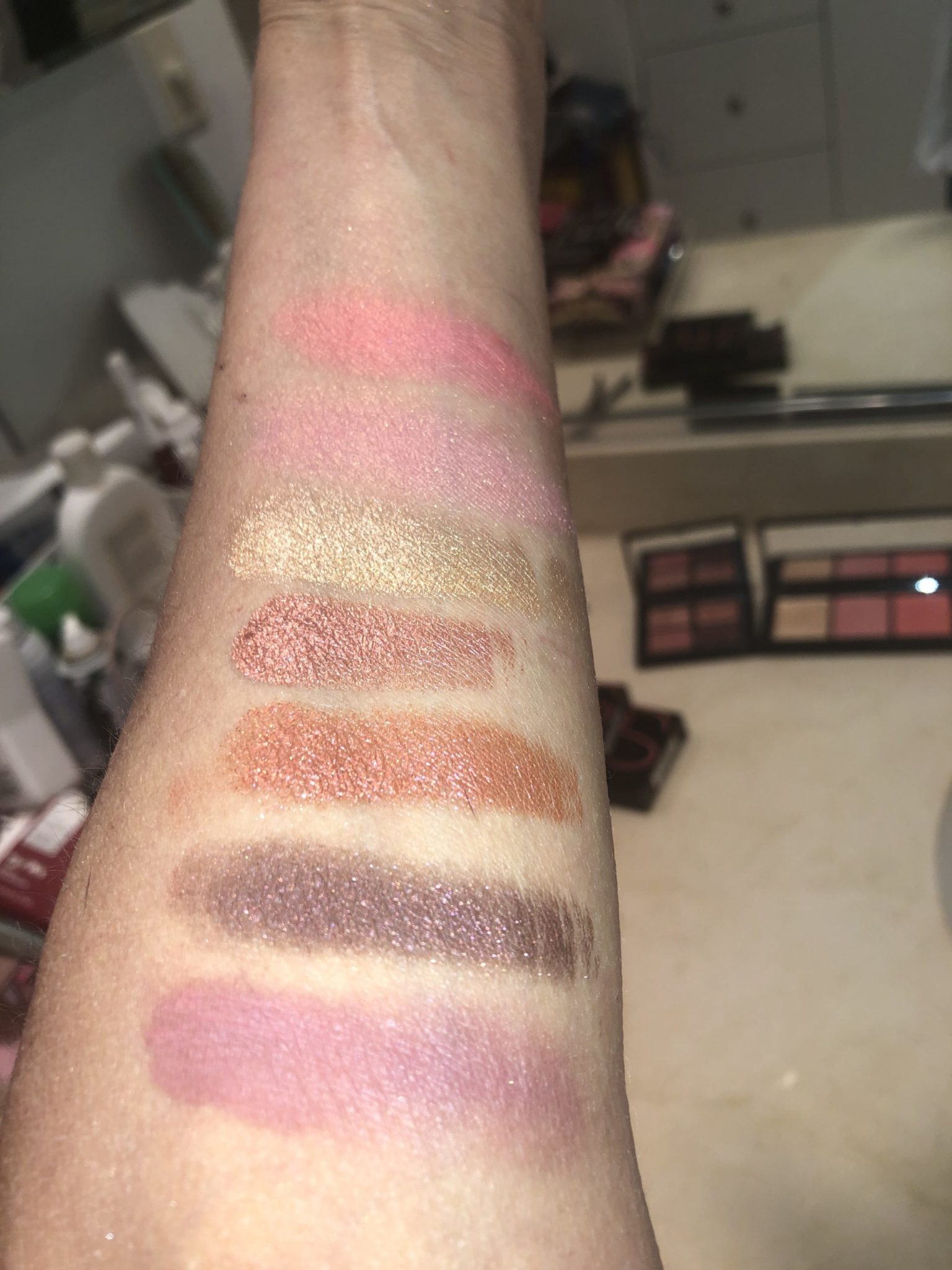 SWATCHES TOP TO BOTTOM: CHEEKS ORGASM X, ORGASM, ORGASM HIGHLIGHTER, PINK RUST SHIMMER EYESHADOW, SPARKLING AMBER EYESHADOW, BLACK WITH RED SHIMMER, DUSTY ROSE MATTE
