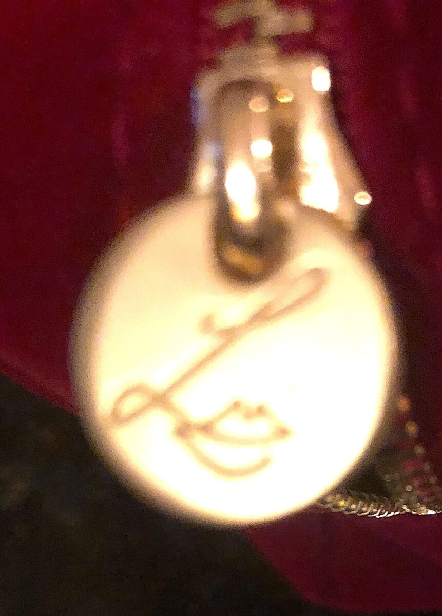 THE ZIPPER PULL HAS LISA ELDRIDGE'S SIGNATURE LOGO