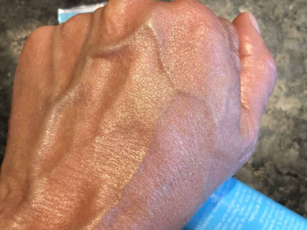 PURLISSE MOISTURIZER/SUNSCREEN SPF 30 RUBBED INTO THE HAND