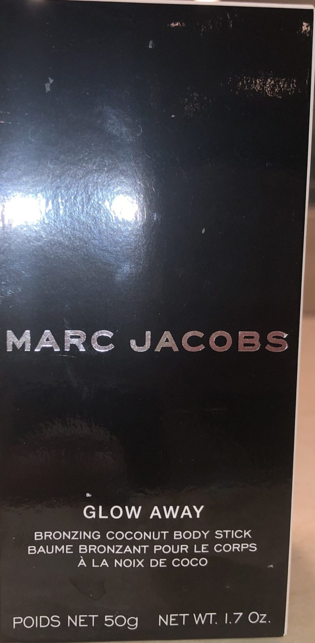 THE OUTER BOX FOR THE MARC JACOBS GLOW AWAY BRONZING COCONUT BODY STICK