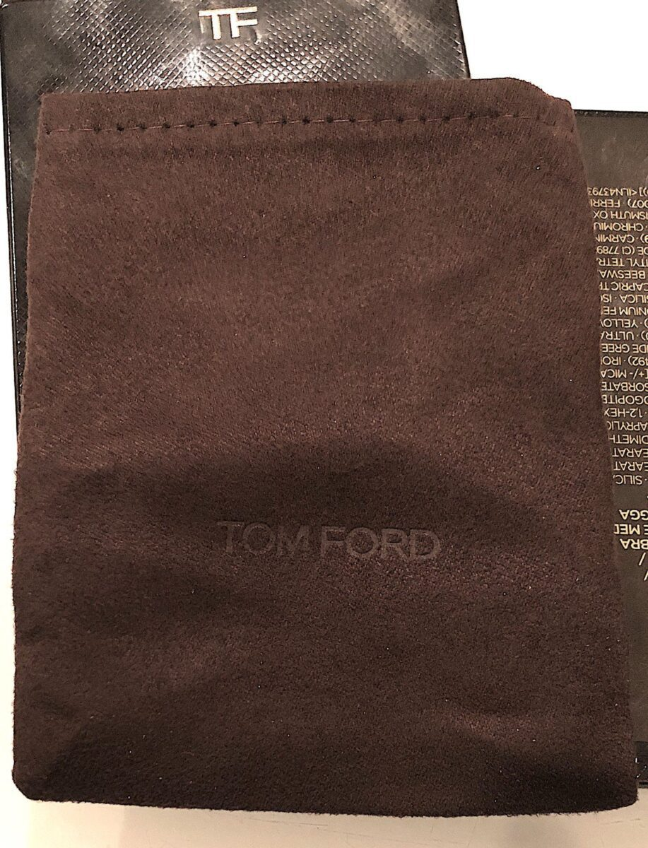THE FAUX SUEDE LITTLE BROWN BAG THAT HOLDS THE TOM FORD 2020 EYESHADOW QUADS