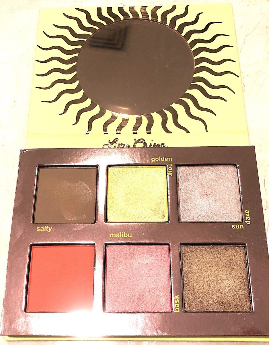 THE LIME CRIME SUNKISSED FACE PALETTE HAS A SUNNY ROUND MIRROR, A ROSE GOLD INTERIOR, AND LARGE PANS OF POWDER