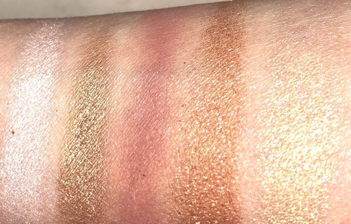 THE SWATCHES FROM LEFT TO RIGHT ARE SKINSHOW MOON GLOW, BRONZE ECLIPSE, VERMILLION VENOM, BLOOD MOOON, AND JUBILEE