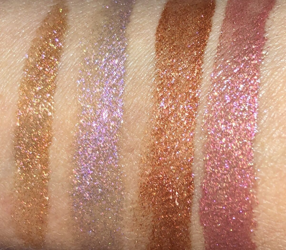 SWATCHES LEFT TO RIGHT: DREAMSCAPE, LAVENDARING, BRONZE SEDUCTREESS, AND NAKED ROSE