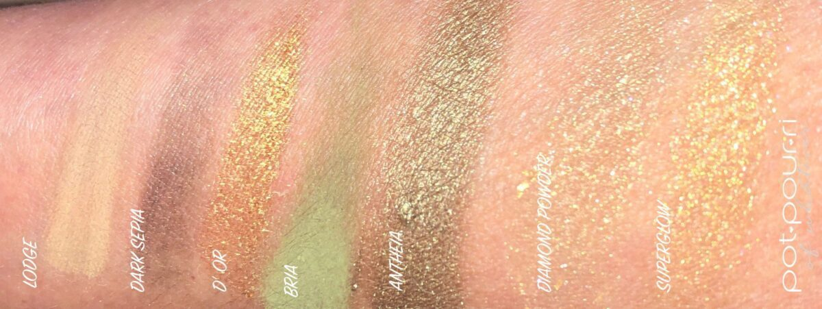 SWATCHES FROM THE MINI GOLD EYESHADOW PALETTE, AND TWO SWATCHES FROM THE GLOW GOLD PALETTE