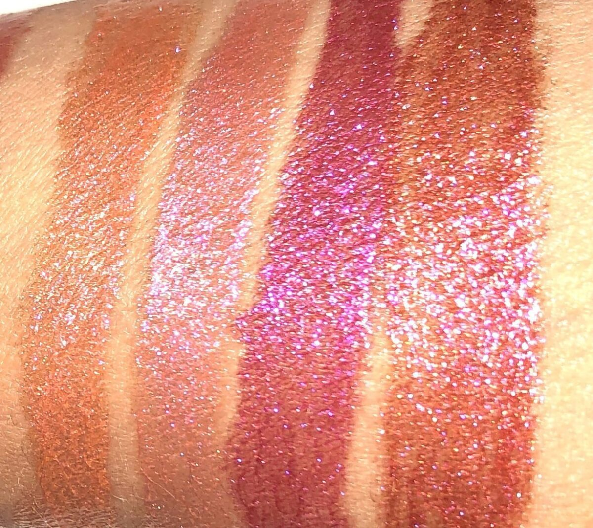SWATCHES LEFT TO RIGHT: CORALIASON, UNDER YOUR SPELL, VENOMISTRESS, AND GLOWING GARNET