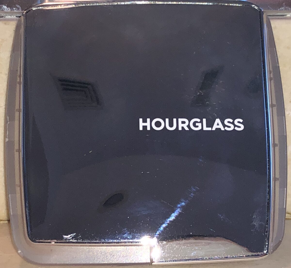 THE HOURGLASS GHOST BLUSH PALETTE CASE TOP IS MIRRORED SILVER, AND BOTTOM IS TRANSLUCENT, GHOSTLY PLASTIC