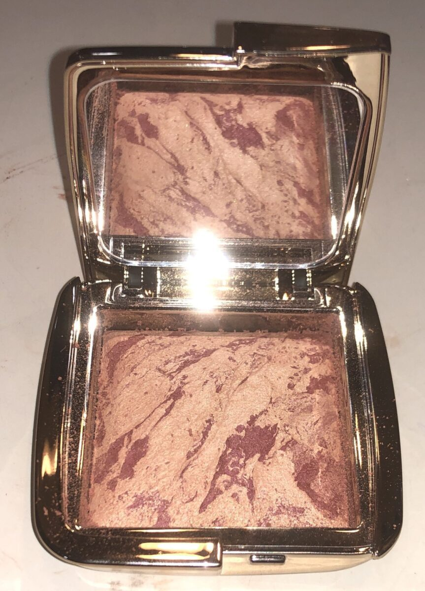 The Ambient Lighting Palette opened, has a large mirror on one side, and a large pan of blush on the other side