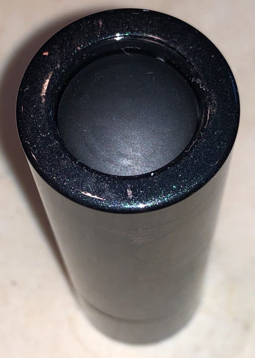 THE DISPENSING BUTTON ON THE BOTTOM OF THE SURRATT DEW DROP FOUNDATION BOTTLE
