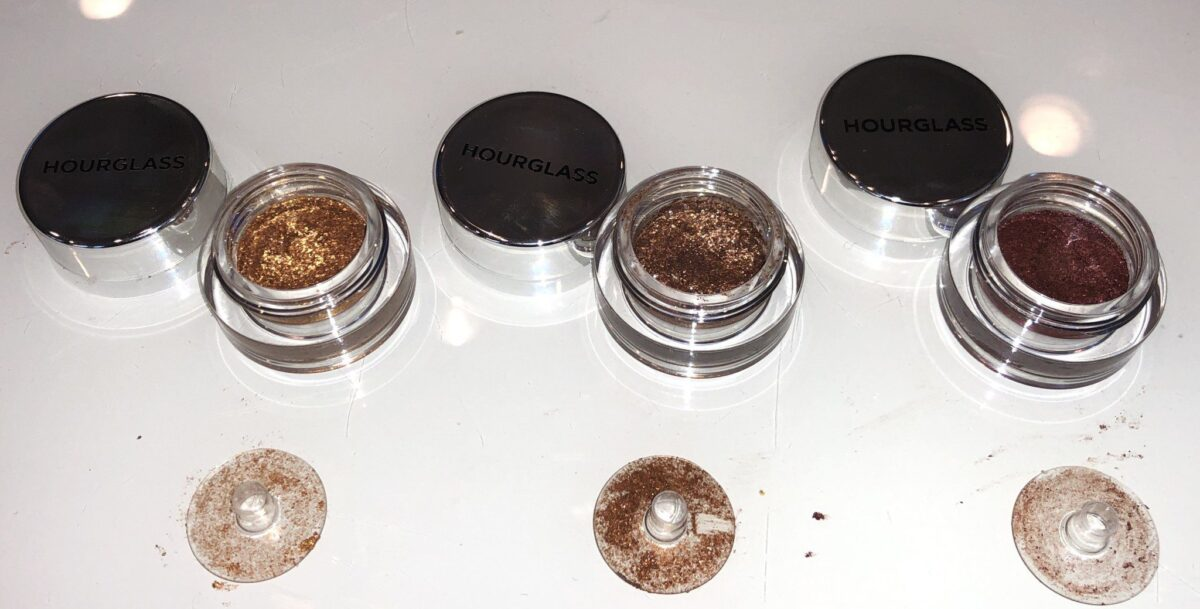 THE SCATTERED LIGHT GLITTER EYESHADOWS JAR AND THE CLEAR DISC