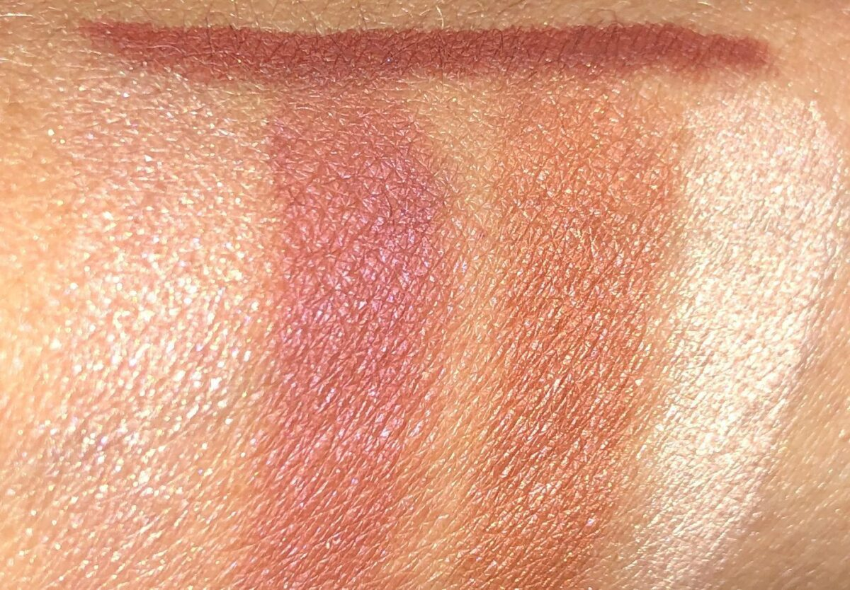 swatch of the Walk Of No Shame Eyeliner above the swatches of the eyeshadow palette