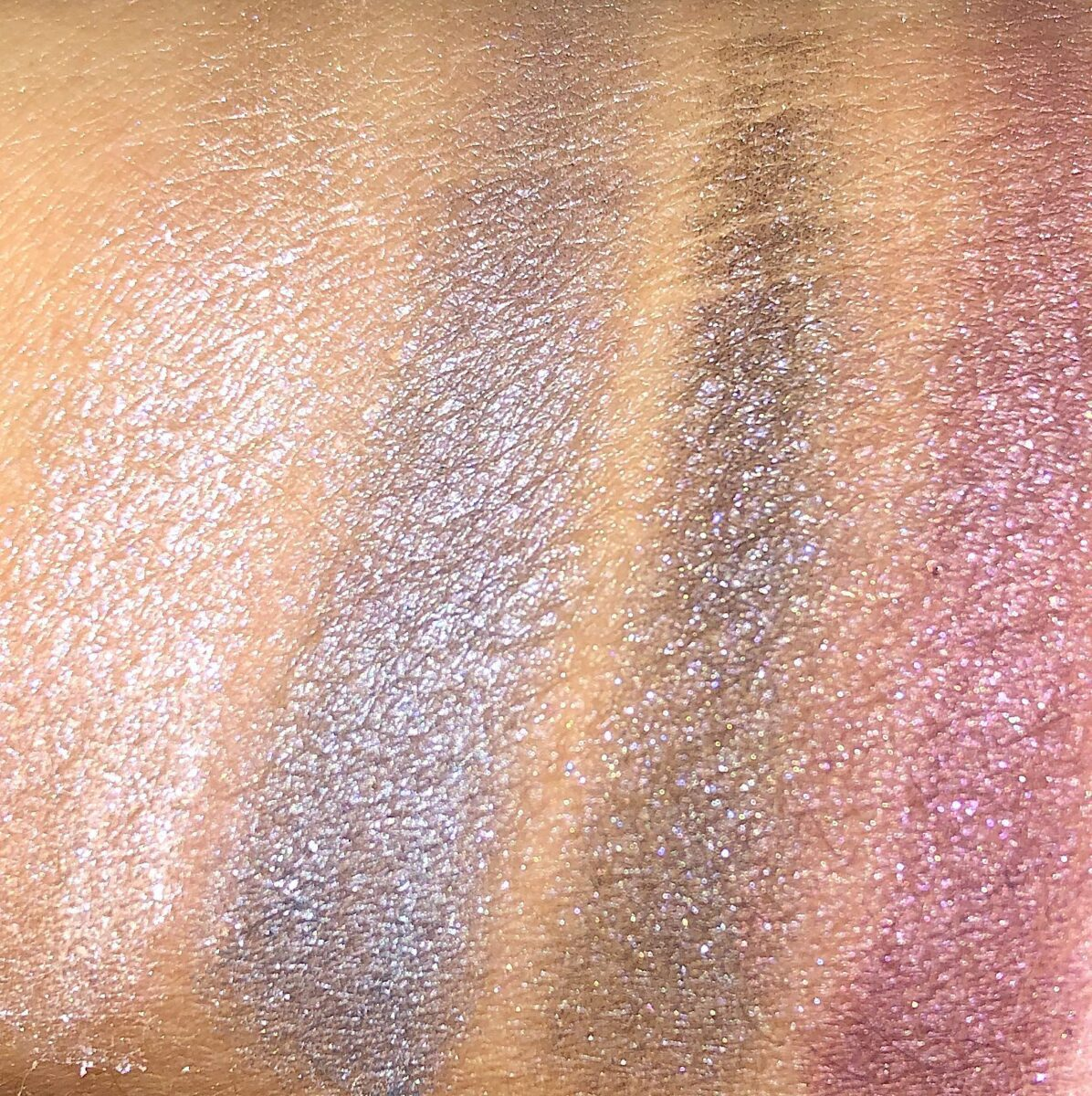 SWATCHES OF THE MIDDLE SHADES IN THE GIVENCHY RED EDITION EYESHADOW PALETTE