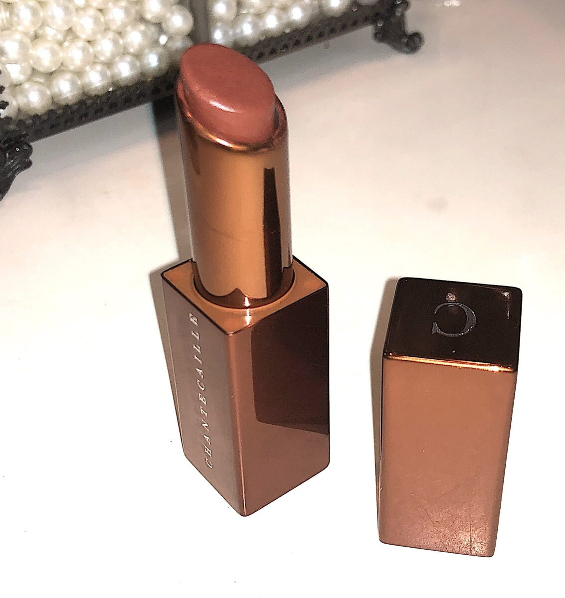 the lip veil is in a bronze bullet, with a magnetic lid