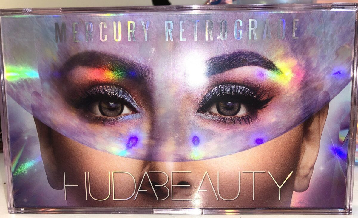 THE OUTER BOX OF THE HUDA MERCURY RETROGRADE COLLECTION EYESHADOW PALETTE