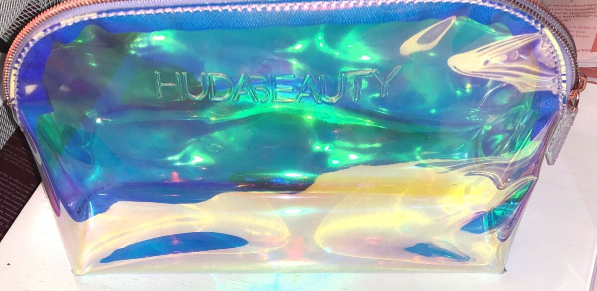 THE BRUSHES FOR THE HUDA MERCURY RETROGRADE COLLECTION COME PACKAGED IN A HOLOGRAPHIC MAKEUP BAG