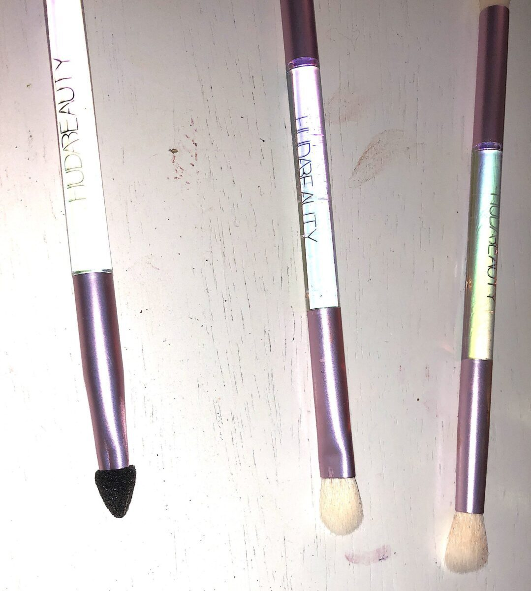 ONE SIDE OF THE HUDA MERCURY RETROGRADE COLLECTION'S DUAL -ENDED BRUSH SET