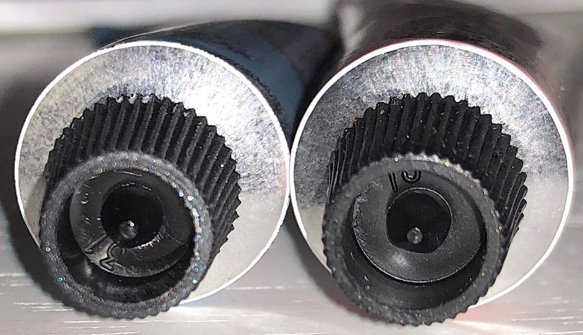 THE SIDE OF THE PAINT TUBE CAP THAT WILL PUNCTURE THE FOIL UNDERNEATH THE CAPS