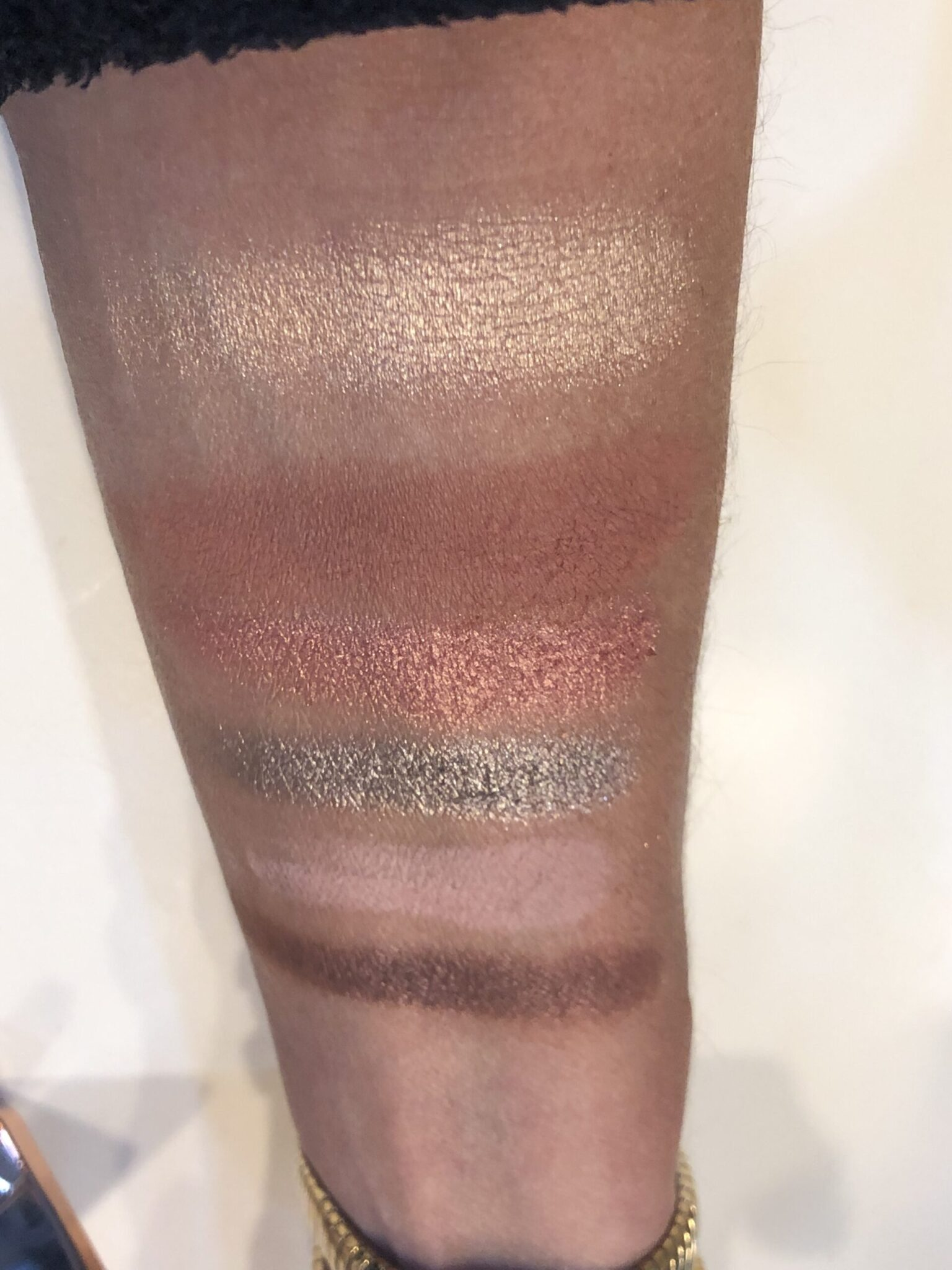 top swatch is Nude Glow Highlighter, Paired with swatches of Mini Zendo Palette