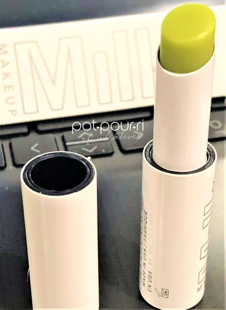 MILK MAKEUP KUSH LIP BALM IN GREEN DRAGON TURNS TRANSLUCENT WHEN APPLIED TO YOUR LIPS