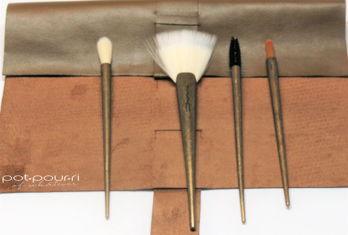 four brass handled brushes included in the roll