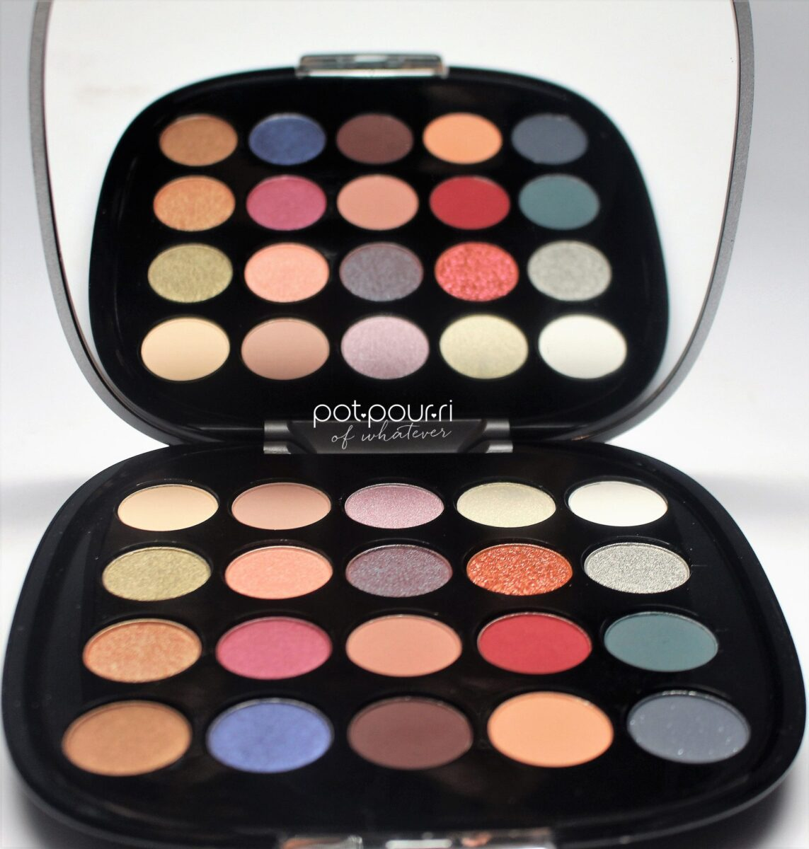 a large mirror and 20 beautiful eyeshadow colors are inside the palette