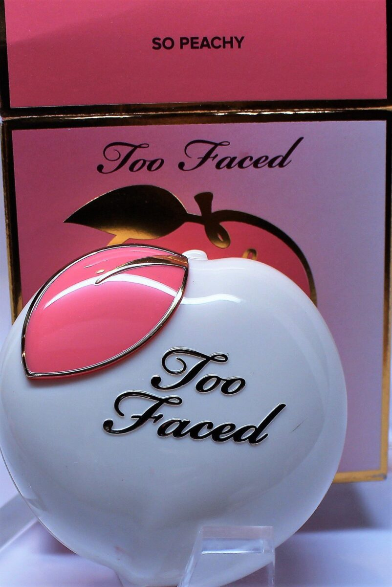 cute compact in the shape of a peach