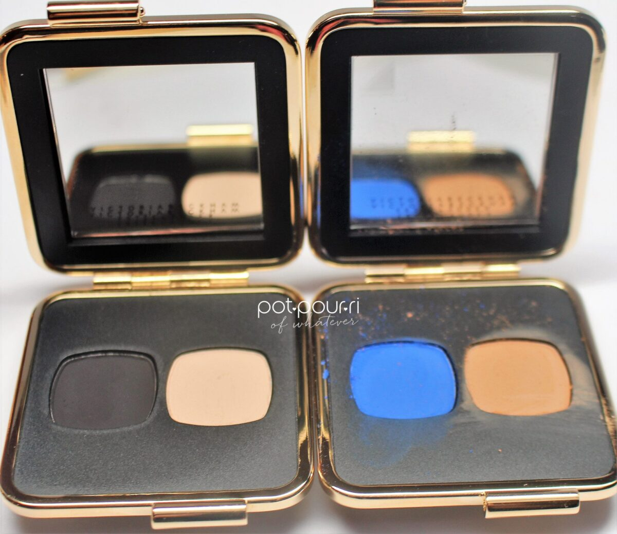the two palettes I own are the black/cream and the bright blue and camel duos