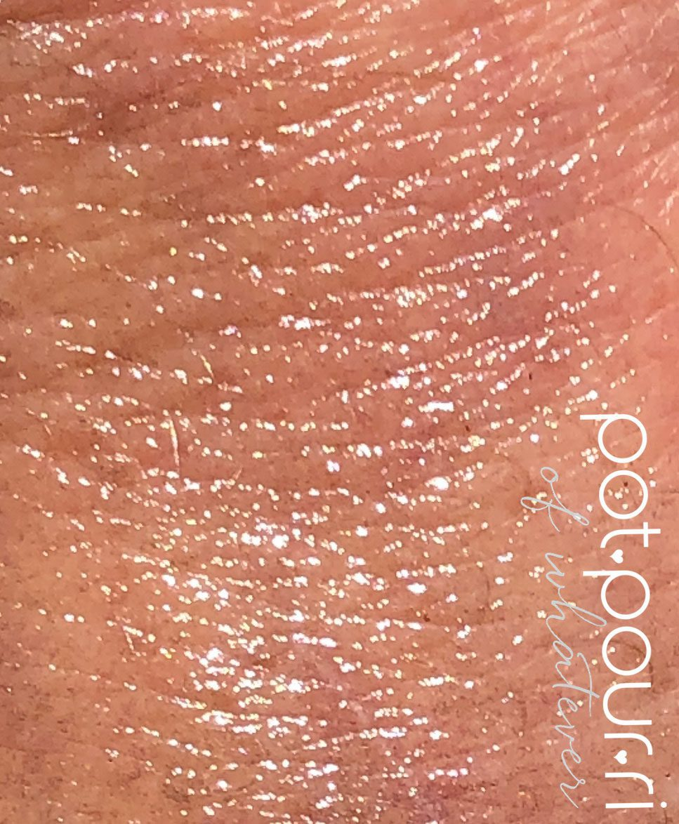 swatch Beauty Blender Opal Essence Serum Primer rubbed into hand