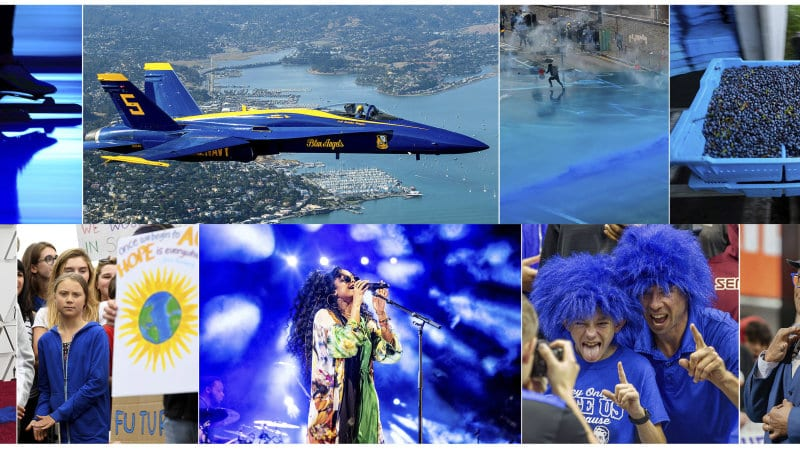 """Skating Sprint in the Netherlands, on Feb. 23, 2019, U.S. Navy Blue Angel flying over Sausalito, Calif., on  Oct. 10, 2019, Police firing blue-colored water at protestors in Hong Kong on Aug. 31, 2019, a tray of wild blueberries at the Coastal Blueberry Service in Union, Maine on Aug. 24, 2018, bottom row from left, actress-writer Tina Fey wearing a blue gown at the Oscars on Feb. 24, 2019, Swedish youth climate activist Greta Thunberg, wearing a blue sweatshirt, during a protest outside the White House in Washington on Sept. 13, 2019, H.E.R. performing under blue lights at the Coachella Music & Arts Festival in Indio, Calif. on April 14, 2019, Duke fans wearing blue wigs before an NCAA college basketball game against Florida State in Tallahassee, Fla., on Jan. 12, 2019 and """"Today"""" show co-host Al Roker wearing blue eye glasses on the set in New York on April 5, 201"""