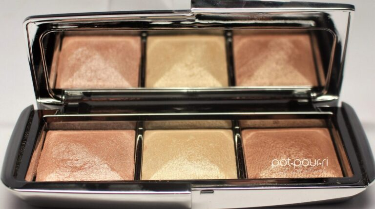 opened compact has three strobe shades and a mirror