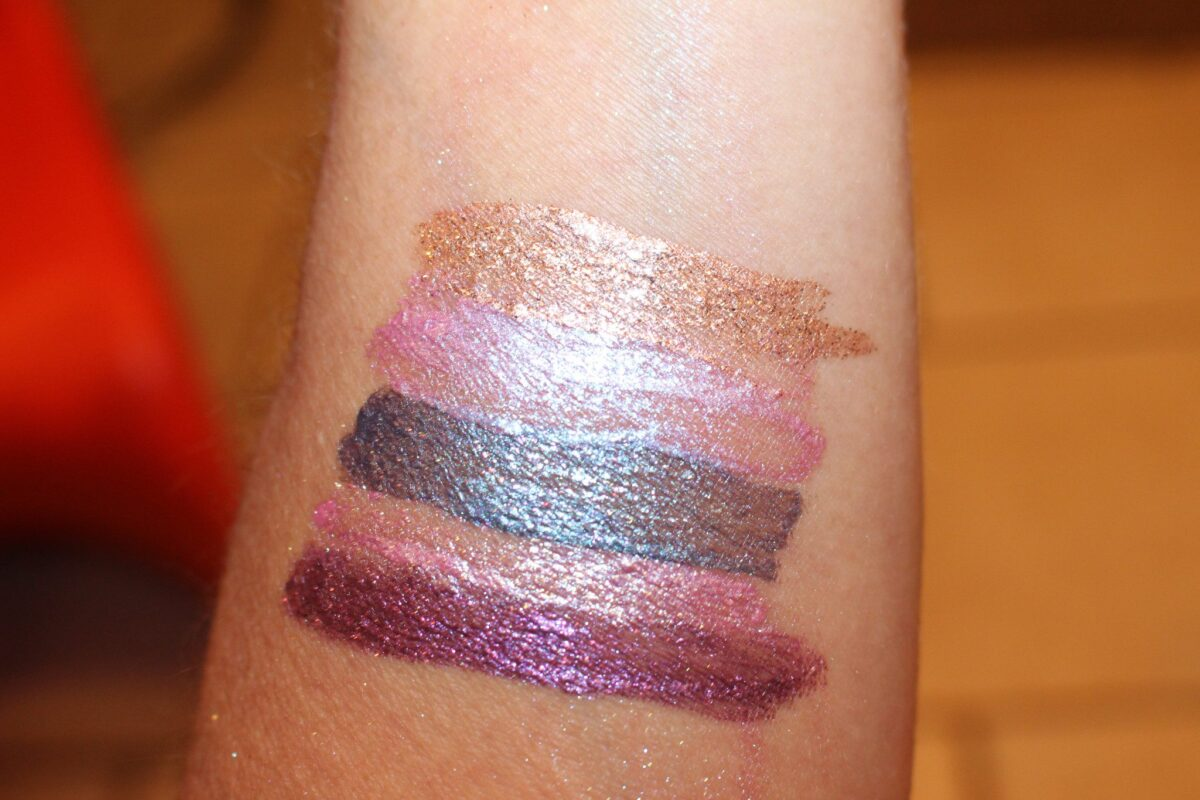 swatches top to bottom kitten Karma, sunset cove, Into the Blue, Sea Siren, and Violet Vixen