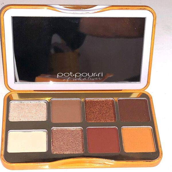 THE HOT BUTTERED RUM PALETTE HAS A MIRROR AND EIGHT EYESHADOWS INSIDE THE COMPACT