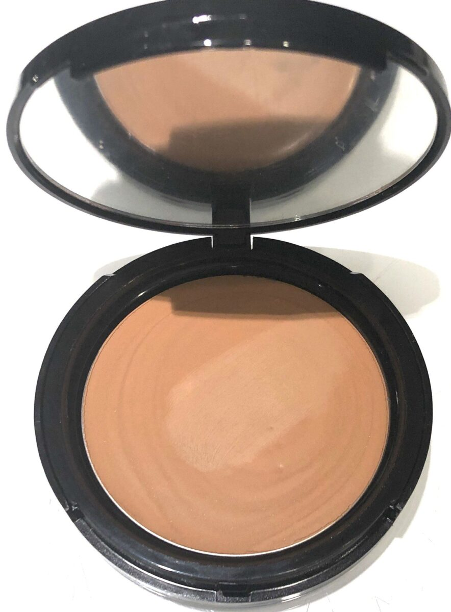 VOODOO MAKEUP COCONUT CREAM FOUNDATION POWDER OPENED COMPACT HAS TANNED BEAUTY FOUNDATION AND A FULL-SIZED MIRROR, AND IS MADE WITH STURY PLASTIC